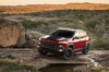 Picture of a 2017 Jeep Cherokee Trailhawk 4WD in Deep Cherry Red Crystal Pearlcoat from a front left three-quarter perspective