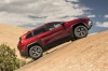 Picture of a 2017 Jeep Cherokee Trailhawk 4WD in Deep Cherry Red Crystal Pearlcoat from a side perspective