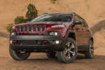 Picture of a 2017 Jeep Cherokee Trailhawk 4WD in Deep Cherry Red Crystal Pearlcoat from a front left perspective
