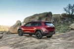 Picture of a 2017 Jeep Cherokee Trailhawk 4WD in Deep Cherry Red Crystal Pearlcoat from a rear left three-quarter perspective