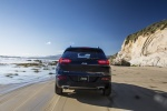Picture of a driving 2017 Jeep Cherokee Limited 4WD from a rear perspective