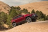 2018 Jeep Cherokee Trailhawk 4WD in Red from a front right three-quarter view