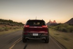 Picture of a driving 2018 Jeep Cherokee Limited 4WD in Red from a rear perspective