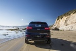 Picture of a driving 2018 Jeep Cherokee Limited 4WD from a rear perspective