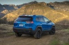 2019 Jeep Cherokee Trailhawk 4WD in Hydro Blue Pearlcoat from a rear right view
