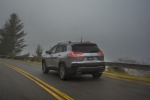 Picture of a driving 2019 Jeep Cherokee Limited 4WD in Billet Silver Metallic Clearcoat from a rear left perspective
