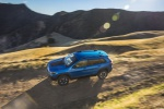 Picture of a driving 2019 Jeep Cherokee Trailhawk 4WD in Hydro Blue Pearlcoat from a left side top perspective