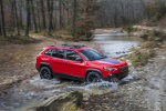 Picture of a driving 2019 Jeep Cherokee Trailhawk 4WD in Firecracker Red Clearcoat from a front right three-quarter perspective