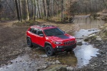 Picture of a driving 2019 Jeep Cherokee Trailhawk 4WD in Firecracker Red Clearcoat from a front right perspective
