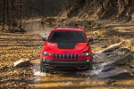 Picture of a driving 2019 Jeep Cherokee Trailhawk 4WD in Firecracker Red Clearcoat from a frontal perspective