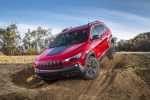 Picture of a driving 2019 Jeep Cherokee Trailhawk 4WD in Firecracker Red Clearcoat from a front left perspective
