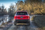 Picture of a driving 2019 Jeep Cherokee Trailhawk 4WD in Firecracker Red Clearcoat from a rear perspective