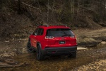 Picture of a 2019 Jeep Cherokee Trailhawk 4WD in Firecracker Red Clearcoat from a rear left perspective