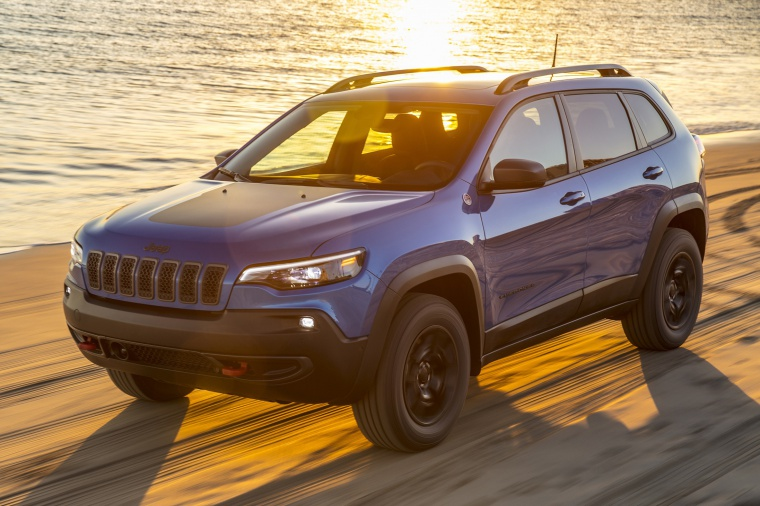 Picture of a driving 2020 Jeep Cherokee Trailhawk 4WD in Hydro Blue Pearlcoat from a front left three-quarter perspective