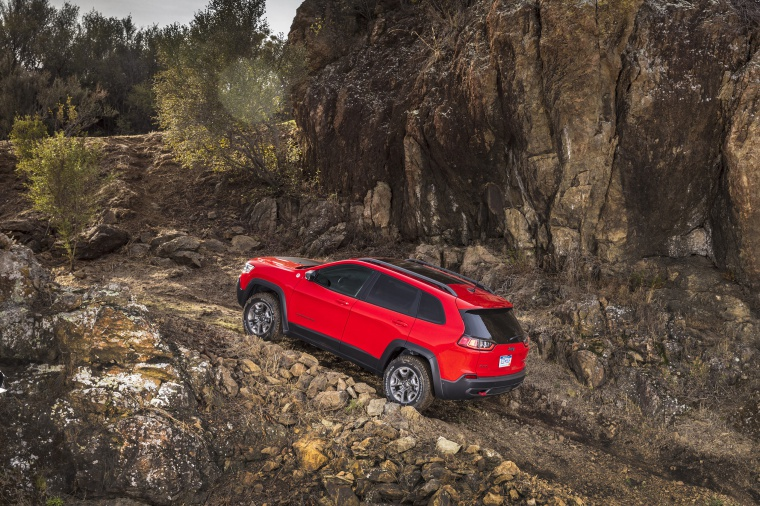 Picture of a driving 2020 Jeep Cherokee Trailhawk 4WD from a rear left three-quarter perspective