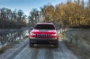 Picture of a driving 2020 Jeep Cherokee Trailhawk 4WD from a frontal perspective
