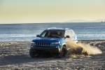 Picture of a driving 2020 Jeep Cherokee Trailhawk 4WD in Hydro Blue Pearlcoat from a front left perspective