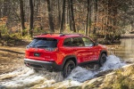 Picture of a driving 2020 Jeep Cherokee Trailhawk 4WD from a rear right three-quarter perspective
