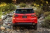 2020 Jeep Compass Trailhawk 4WD in Spitfire Orange Clearcoat from a rear view
