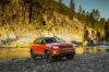 2020 Jeep Compass Trailhawk 4WD in Spitfire Orange Clearcoat from a front right three-quarter view