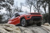 2020 Jeep Compass Trailhawk 4WD in Spitfire Orange Clearcoat from a front right view