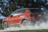 2020 Jeep Compass Trailhawk 4WD in Spitfire Orange Clearcoat from a rear left view