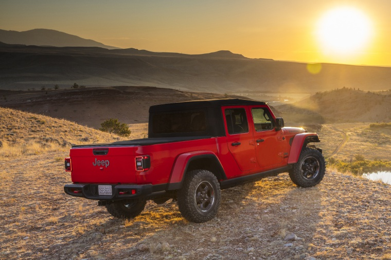 2020 Jeep Gladiator Crew Cab Rubicon 4WD in Firecracker Red Clearcoat from a rear right three-quarter view