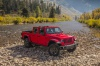 2020 Jeep Gladiator Crew Cab Rubicon 4WD without roof in Firecracker Red Clearcoat from a front right view