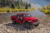 2020 Jeep Gladiator Crew Cab Rubicon 4WD without doors and roof in Firecracker Red Clearcoat from a front right view