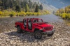 2020 Jeep Gladiator Crew Cab Rubicon 4WD with windshield folded in Firecracker Red Clearcoat from a front right view
