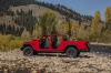 2020 Jeep Gladiator Crew Cab Rubicon 4WD with windshield folded in Firecracker Red Clearcoat from a side view