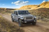 Driving 2020 Jeep Gladiator Crew Cab Overland 4WD in Billet Silver Metallic Clearcoat from a front right view