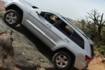 2013 Jeep Grand Cherokee in Bright Silver Metallic Clearcoat - Driving Side View