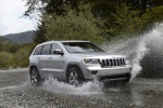 2013 Jeep Grand Cherokee in Bright Silver Metallic Clearcoat - Driving Front Right Three-quarter View