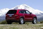 2013 Jeep Grand Cherokee Limited 4WD in Deep Cherry Red Crystal Pearlcoat - Driving Rear Right Three-quarter View