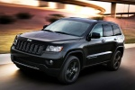 2013 Jeep Grand Cherokee Overland 4WD in Brilliant Black Crystal Pearlcoat - Driving Front Left Three-quarter View