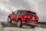 Picture of a 2016 Jeep Grand Cherokee Summit 4WD in Deep Cherry Red Crystal Pearlcoat from a rear left perspective