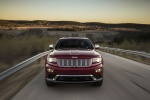 Picture of a driving 2016 Jeep Grand Cherokee Summit 4WD in Deep Cherry Red Crystal Pearlcoat from a frontal perspective