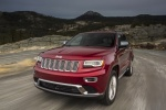 Picture of a driving 2016 Jeep Grand Cherokee Summit 4WD in Deep Cherry Red Crystal Pearlcoat from a front left three-quarter perspective