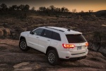 Picture of a 2016 Jeep Grand Cherokee Limited 4WD in Bright White Clearcoat from a rear left perspective