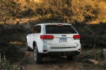 Picture of a 2016 Jeep Grand Cherokee Limited 4WD in Bright White Clearcoat from a rear perspective