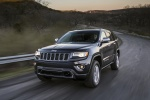 Picture of a driving 2016 Jeep Grand Cherokee Limited Diesel 4WD in Granite Crystal Metallic Clearcoat from a front left three-quarter perspective