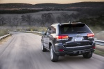 Picture of a driving 2016 Jeep Grand Cherokee Limited Diesel 4WD in Granite Crystal Metallic Clearcoat from a rear left perspective