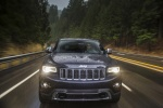 Picture of a driving 2016 Jeep Grand Cherokee Limited Diesel 4WD in Granite Crystal Metallic Clearcoat from a frontal perspective