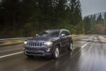 Picture of a driving 2016 Jeep Grand Cherokee Limited Diesel 4WD in Granite Crystal Metallic Clearcoat from a front left perspective