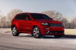 Picture of a 2016 Jeep Grand Cherokee SRT 4WD in Redline 2 Coat Pearl from a front right three-quarter perspective