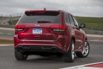 Picture of a 2016 Jeep Grand Cherokee SRT 4WD in Redline 2 Coat Pearl from a rear right perspective