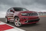 Picture of a 2016 Jeep Grand Cherokee SRT 4WD in Redline 2 Coat Pearl from a front right perspective