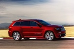 Picture of a driving 2016 Jeep Grand Cherokee SRT 4WD in Redline 2 Coat Pearl from a front right three-quarter perspective