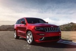 Picture of a driving 2016 Jeep Grand Cherokee SRT 4WD in Redline 2 Coat Pearl from a front right perspective